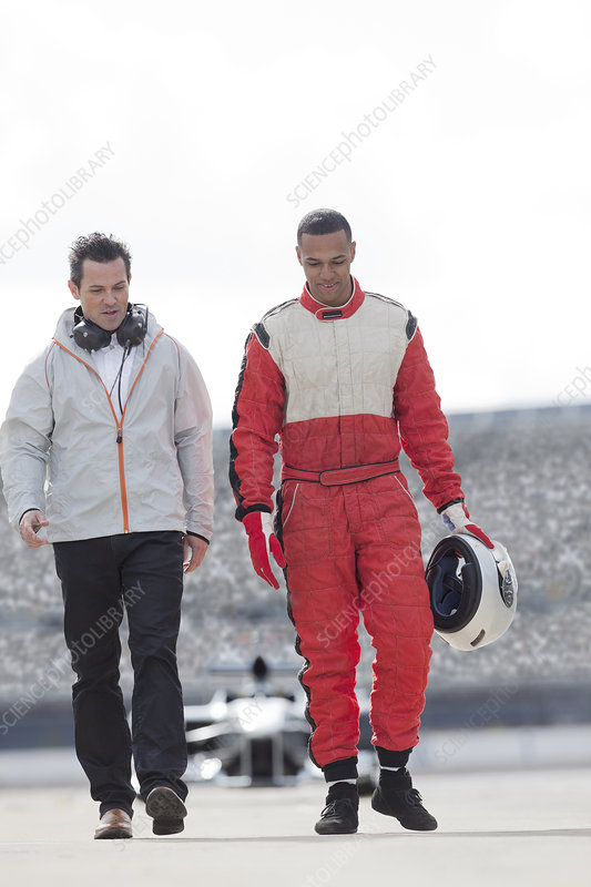 Racer and manager walking on track
