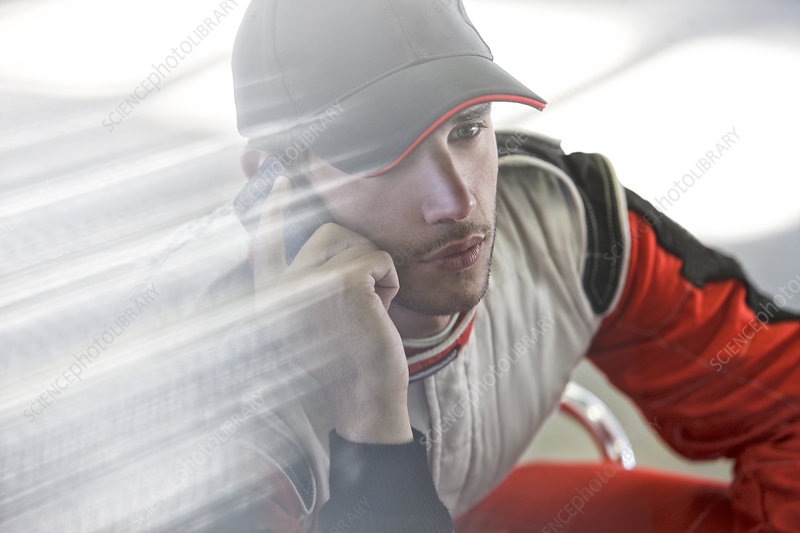 Racer talking on cell phone
