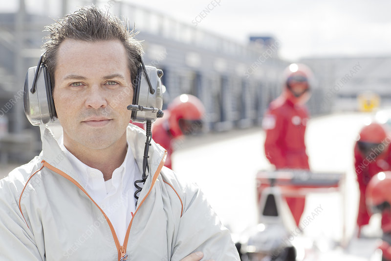 Race manager wearing headphones on track