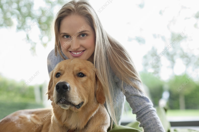 Woman relaxing with dog indoors