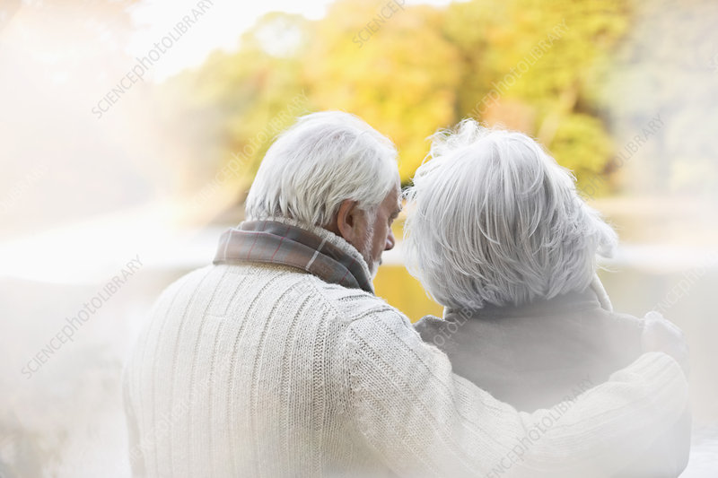 Older couple standing together in park