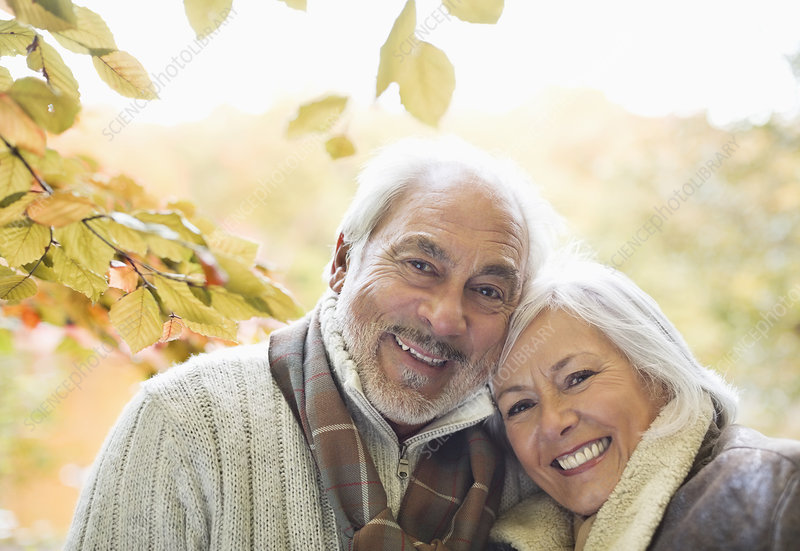 Older couple smiling in park