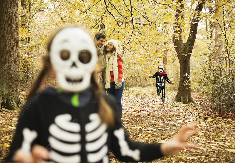 Children in skeleton costumes in park