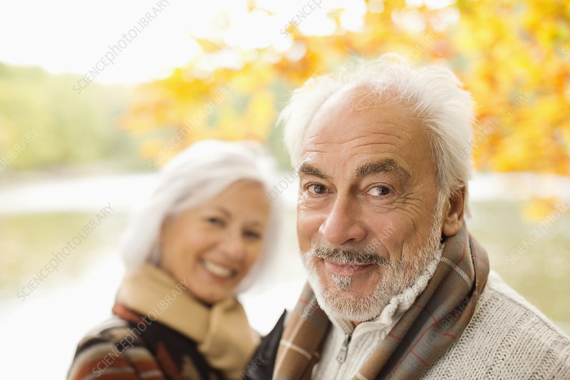 Older couple standing in park