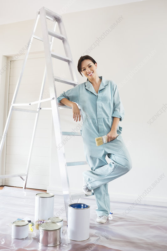 Woman smiling and painting room