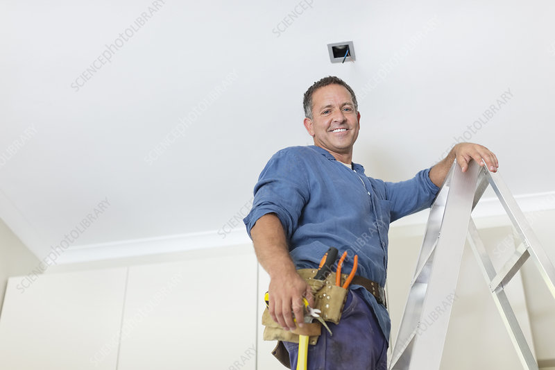 Man working on ceiling lights