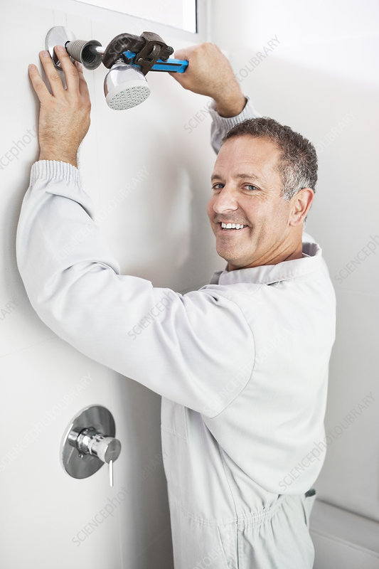 Plumber working on shower head