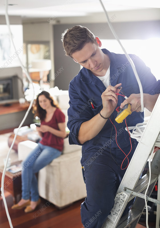 Electrician working in home
