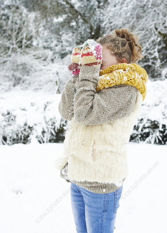Girl playing in snow