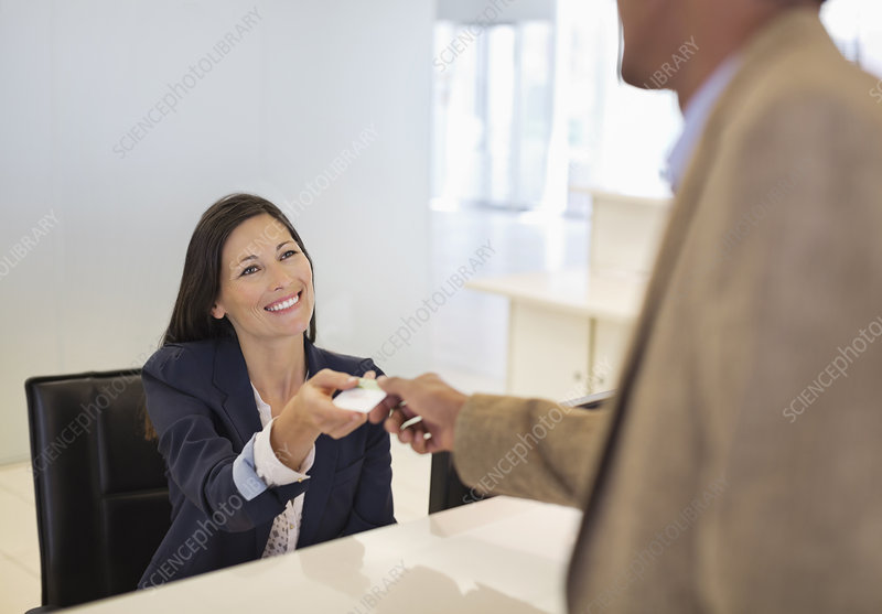 Business people exchanging cards