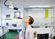 Businessman examining security camera