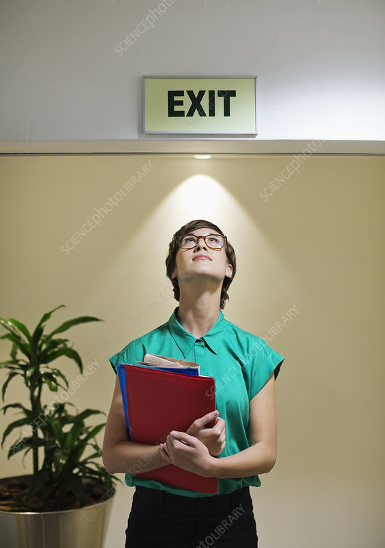 Businesswoman under office Exit sign