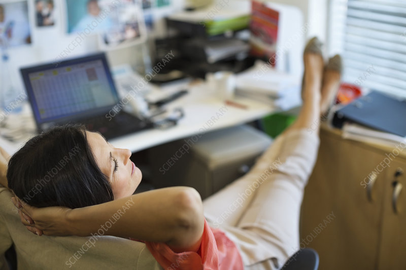 Businesswoman relaxing at desk