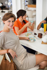Pregnant woman having coffee with friends