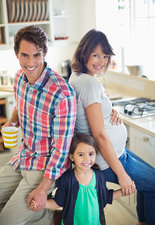 Family smiling together in kitchen