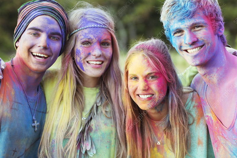 Friends covered in chalk dye