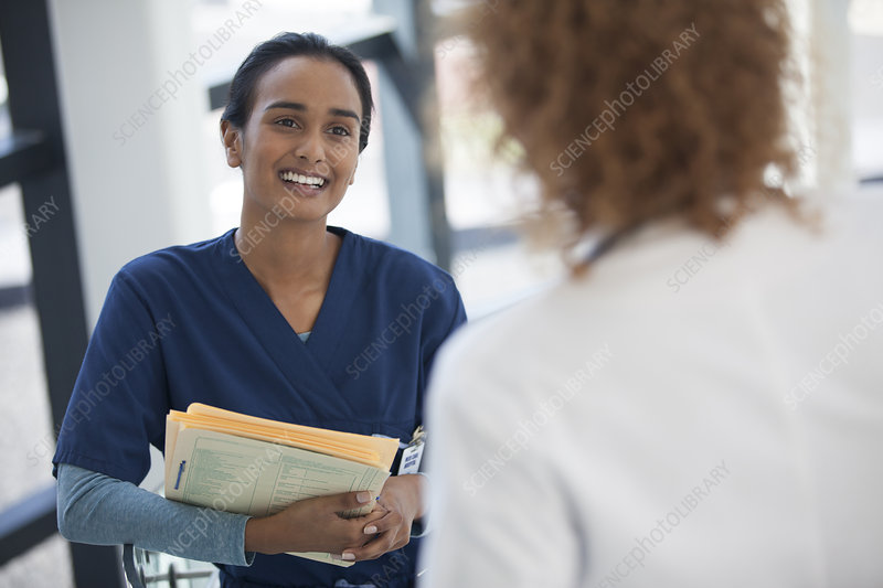 Nurse and doctor talking in hospital