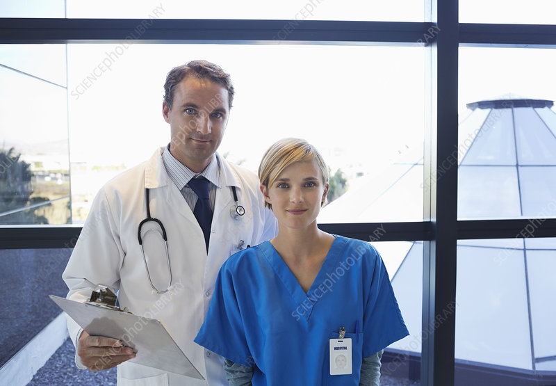 Doctor and nurse standing by window