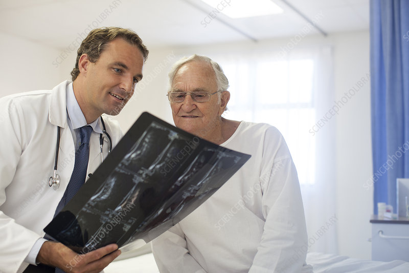 Doctor and patient examining x-rays