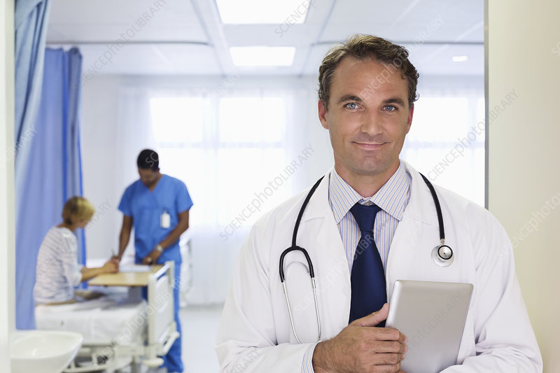 Doctor carrying tablet computer