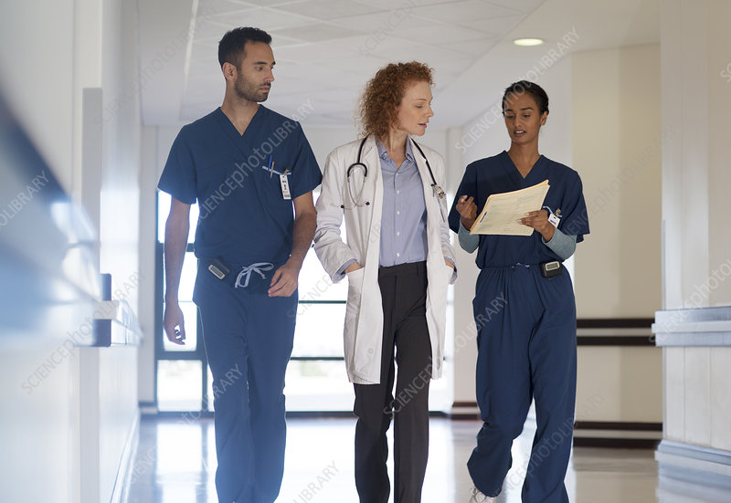 Hospital staff talking in hallway