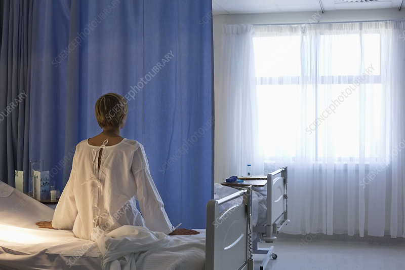 Patient wearing gown on hospital bed