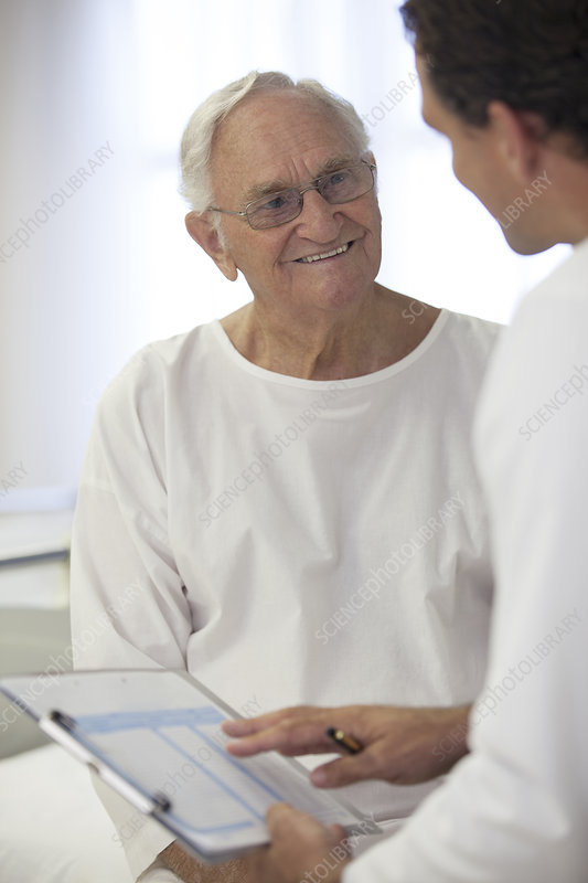 Doctor talking with older patient room