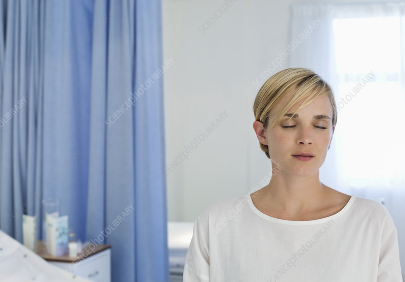 Patient sitting on bed in hospital room