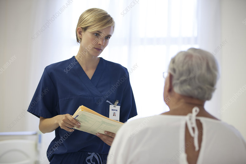 Nurse and older patient talking room