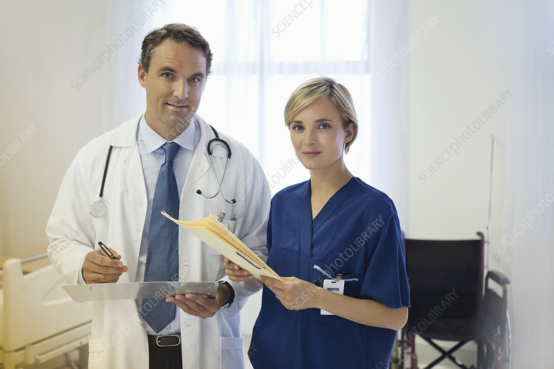 Doctor and nurse talking in hospital room