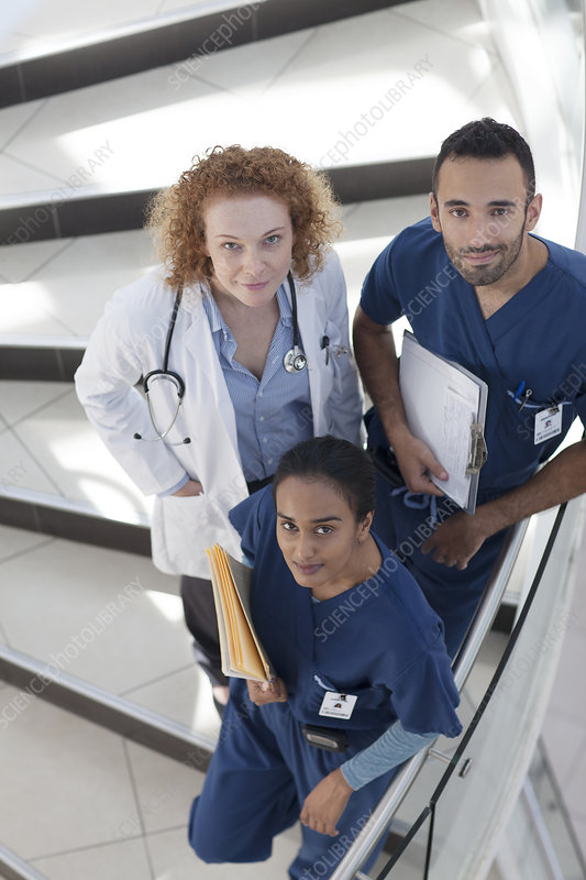 Doctor and nurses on hospital steps