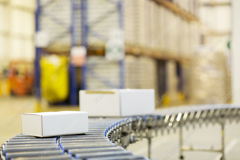 Packages on conveyor belt in warehouse