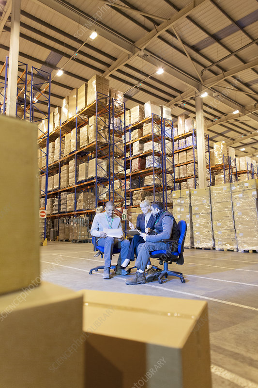 Business people talking in warehouse