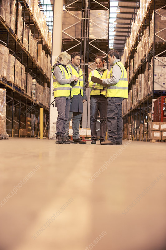 Workers talking in warehouse