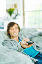 Man watching television in beanbag chair