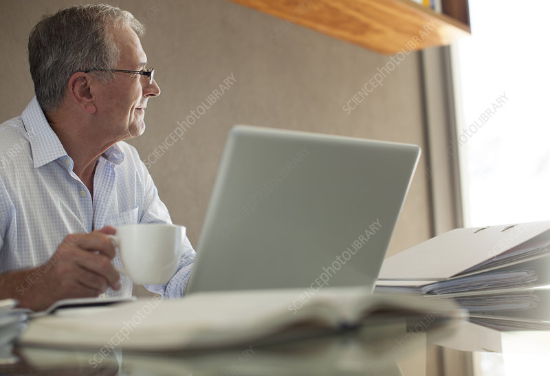Businessman having cup of coffee