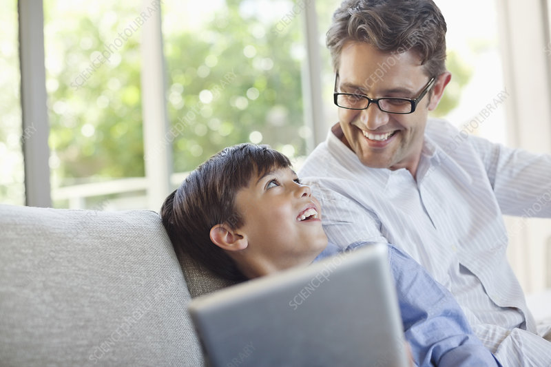 Father and son using tablet computer