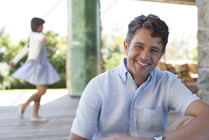 Man smiling on porch