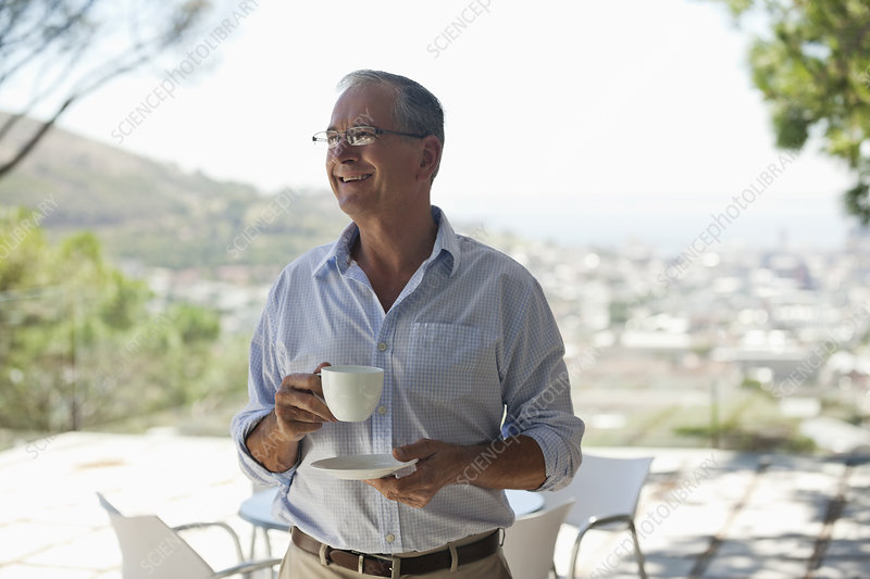 Man drinking cup of coffee outdoors