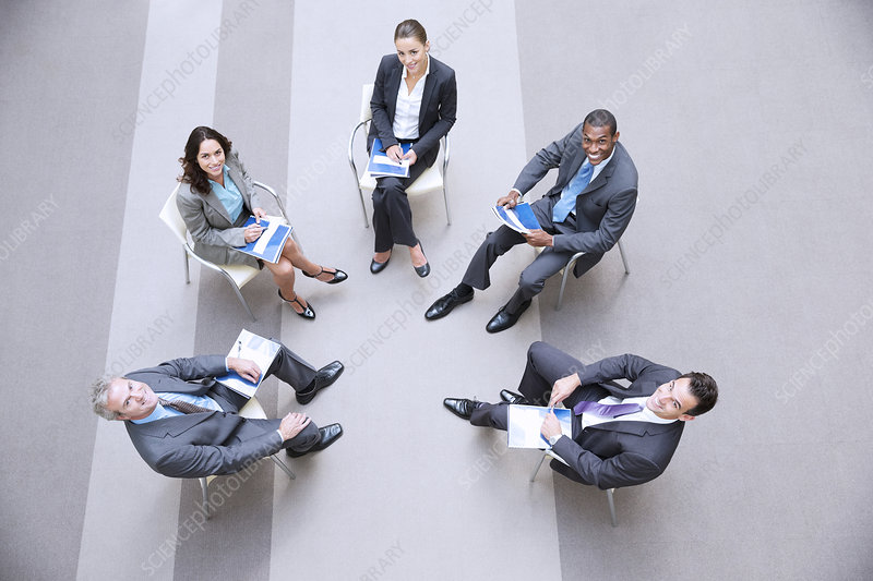 Smiling business people meeting in circle