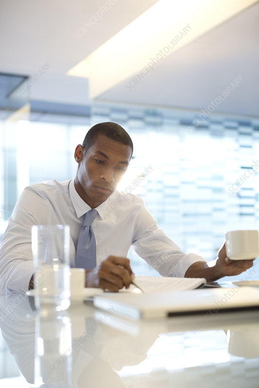 Serious businessman reading paperwork