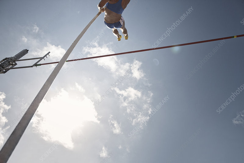 Pole vaulter clearing bar