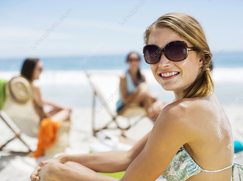Portrait of smiling woman at beach