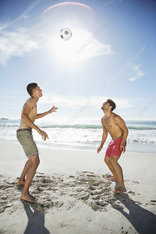 Men in swim trunks on beach