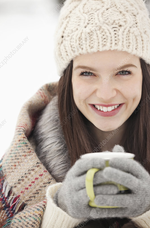 Woman in knit hat and gloves