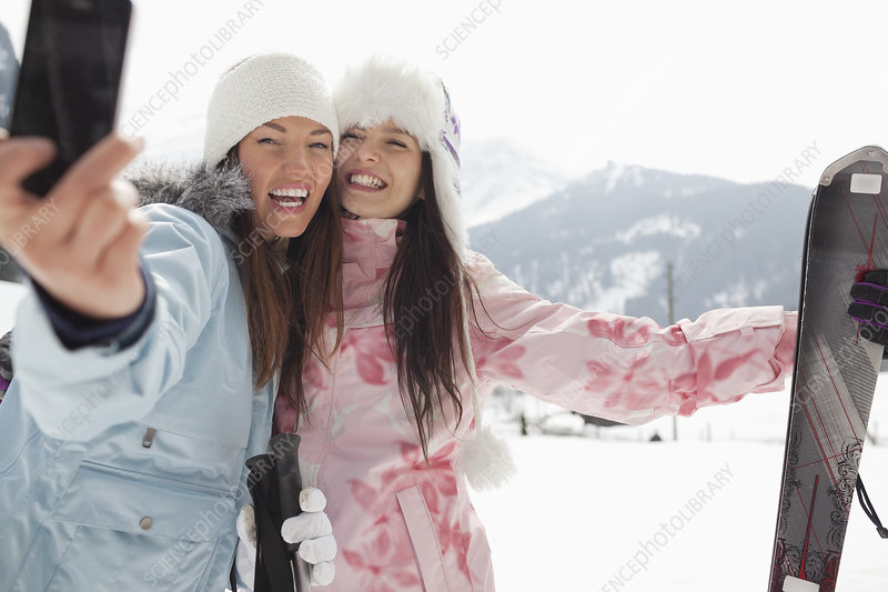 Enthusiastic women with skis