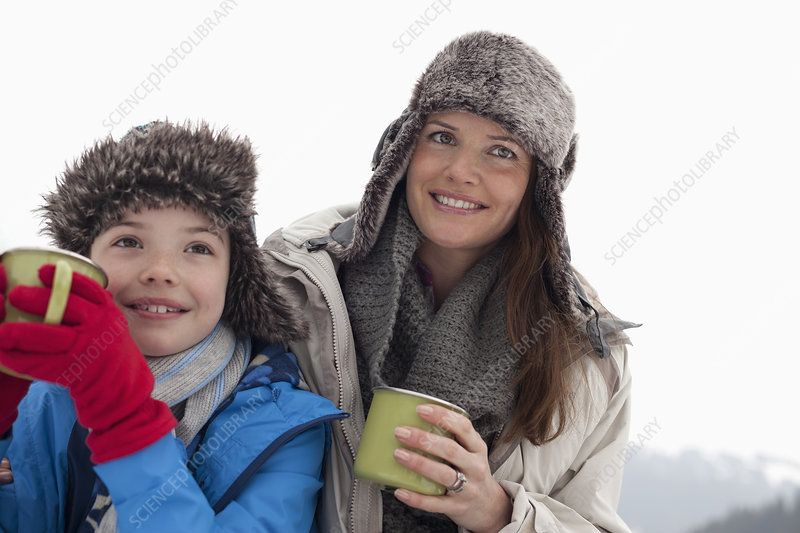 Happy mother and son in fur hats