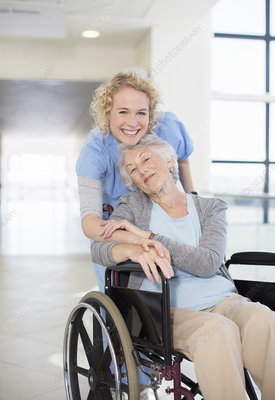 Smiling nurse and elderly patient