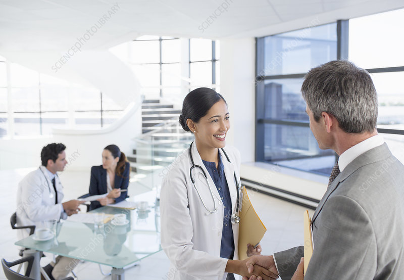 Doctor and businessman handshaking