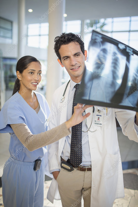 Doctor and nurse viewing head x-rays